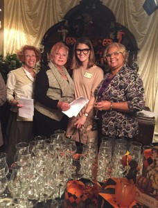 Lynn, Sue and Deborah greet Mallory, a new member, (second from right) at the wine tasting.